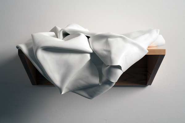 Crumpled White Painting on a Shelf